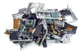 Broken mass digital cameras  on a garbage dump